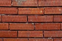 Fundo do tijolo textured ondulado vermelho Fotografia de Stock Royalty Free