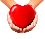 Fundo do Valentim do feriado com as mãos que guardam o coração vermelho Imagens de Stock
