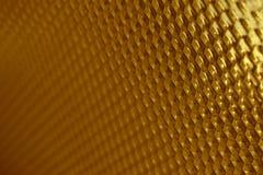 Fundo do vidro dourado foto de stock