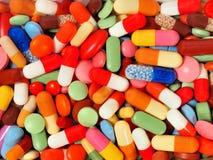 Fundo dos comprimidos e das cápsulas foto de stock