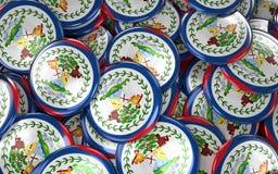 Fundo dos crachás de Belize - pilha de botões belizences da bandeira Fotografia de Stock