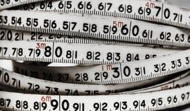Fundo dos números zero a nove Fundo com números Textura dos números Fita de medição correia do medidor Imagem de Stock