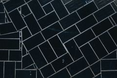 fundo dos quadrados pretos com texturas e as listras brancas fotografia de stock royalty free