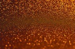 Fundo dos Sparkles do brilho do ouro imagens de stock royalty free