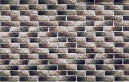 Fundo dos tijolos de clinquer escuros da alvenaria na parede, que são usados no reparo dos locais imagem de stock
