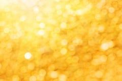 Fundo dourado abstrato das luzes Fotografia de Stock