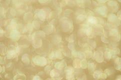 Fundo dourado abstrato Defocused das luzes Fotografia de Stock