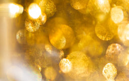 Fundo dourado abstrato do bokeh Luzes defocused douradas spar foto de stock