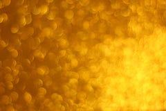 Fundo dourado abstrato do brilho imagens de stock