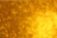 Fundo dourado abstrato do brilho imagens de stock royalty free