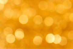 Fundo dourado borrado Foto de Stock