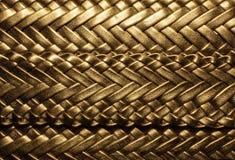 Fundo dourado com trançado Foto de Stock Royalty Free