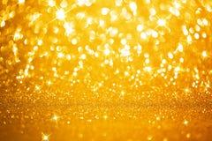 Fundo dourado das luzes Fotografia de Stock