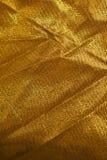 Fundo dourado de pano Fotografia de Stock Royalty Free