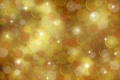 Fundo dourado do bokeh Fotografia de Stock Royalty Free