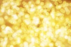Fundo dourado do bokeh Foto de Stock