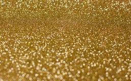 Fundo dourado do brilho borrado imagem de stock royalty free
