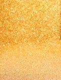 Fundo dourado do glitter Imagens de Stock