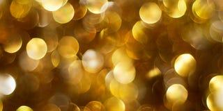 Fundo dourado escuro das luzes Imagens de Stock