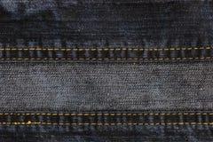 Fundo e textura abstratos de calças de brim da sarja de Nimes fotografia de stock