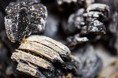 Fundo e textura do carvão vegetal no foco obscuro Fotos de Stock