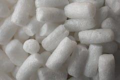 Fundo e textura protetores plásticos da espuma Ideia macro do fundo branco da espuma da embalagem Grânulo protetores plásticos bo Imagem de Stock