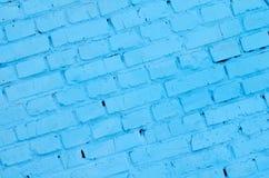Fundo e textura quadrados da parede do bloco do tijolo Pintado no azul fotos de stock royalty free