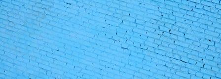 Fundo e textura quadrados da parede do bloco do tijolo Pintado no azul fotografia de stock royalty free