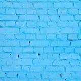 Fundo e textura quadrados da parede do bloco do tijolo Pintado no azul foto de stock royalty free