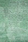 Fundo e textura quadrados da parede do bloco do tijolo Pintado no verde fotos de stock royalty free