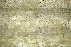 Fundo e textura quadrados da parede do bloco do tijolo Pintado no yello imagem de stock