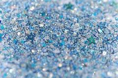 Fundo efervescente congelado azul e de prata do brilho das estrelas do inverno da neve Feriado, Natal, textura do sumário do ano  Imagens de Stock Royalty Free