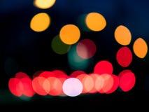 Fundo escuro com os dons coloridos do lense Bolas de Bokeh Configuração lisa fotografia de stock