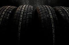 Fundo escuro com pneus do inverno Imagem de Stock Royalty Free
