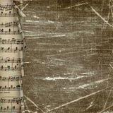 Fundo escuro de Grunge com beira de papel da música Fotografia de Stock Royalty Free