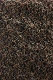 Fundo escuro do chá da folha solta, detalhe dourado preto do close up do teste padrão da textura da mistura das folhas, grande ma imagem de stock