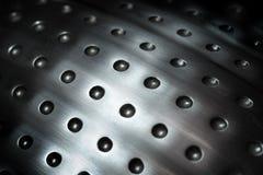 Fundo esférico da superfície de metal com furos Fotografia de Stock Royalty Free