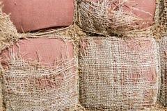 Fundo esfarrapado do pano de saco Serapilheira velha com furo Fotografia de Stock