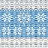 Fundo feito malha do inverno com flocos de neve Imagens de Stock Royalty Free