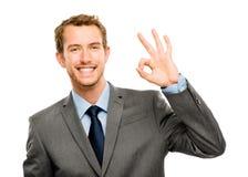 Fundo feliz do branco do sinal da aprovação do homem de negócios Fotografia de Stock Royalty Free