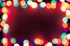 Fundo festivo com frame das luzes Fotografia de Stock Royalty Free