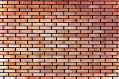 Fundo fino bronzeado da textura da parede de tijolo do bege amarelo vermelho, grande close up horizontal detalhado Foto de Stock
