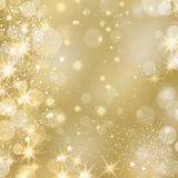 Fundo glinstering dourado com estrelas e luzes Fotografia de Stock Royalty Free