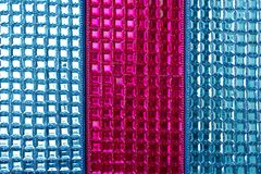 Fundo macro da textura do close up dos sequins coloridos Fotografia de Stock