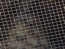 Fundo macro da textura do close-up da grade de aço imagem de stock