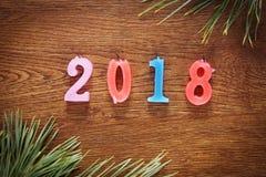 Fundo marrom de madeira sobre o ano novo feliz 2018 Fotografia de Stock Royalty Free