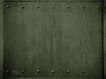 Fundo militar velho da armadura do verde do metal com rebites Fotografia de Stock Royalty Free