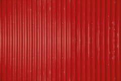 Fundo ondulado vermelho da textura da folha de metal Fotos de Stock