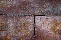 Fundo oxidado gasto da textura do metal do marrom escuro Foto de Stock Royalty Free