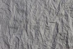 Fundo, papel velho amarrotado, escuro Fotos de Stock Royalty Free
